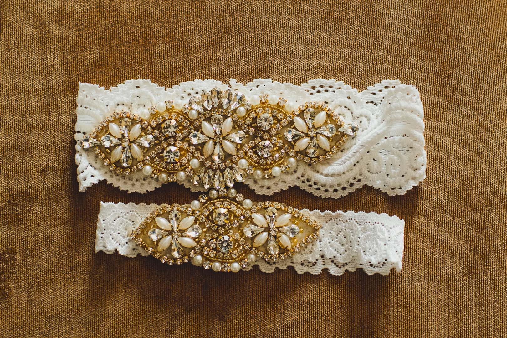 Photo Session of brides details before her wedding ceremony. This was the garter she was wearing before the garter toss. The wedding took place at Villa del Palmar, in Los Cabos, Mexico. Wedding Planning was done by Cabo Wedding Services.