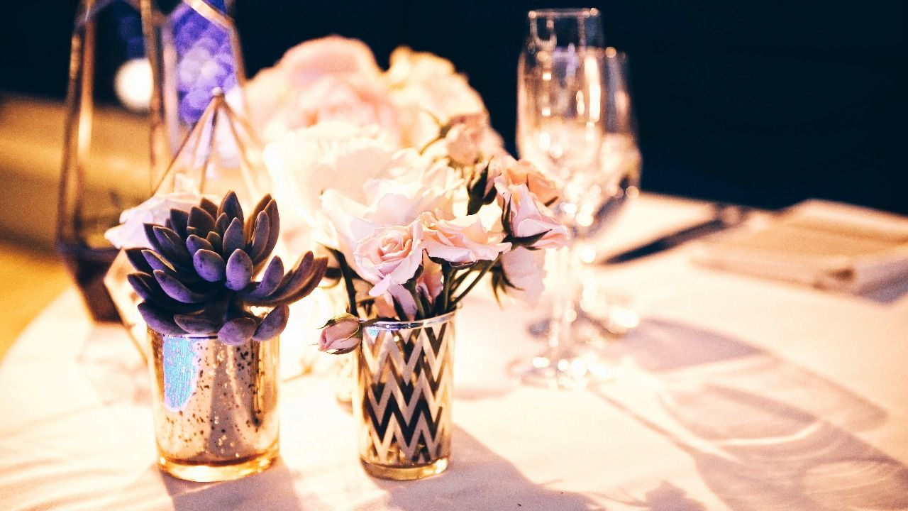 Little details of flowers on the wedding tables. They had roses and succulents, with beautiful candles