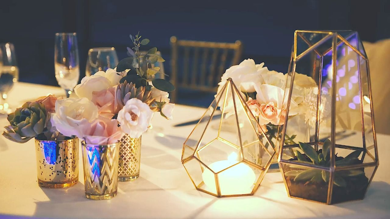 Geometric touches to the tables with roses, succulents and beautiful candle light,