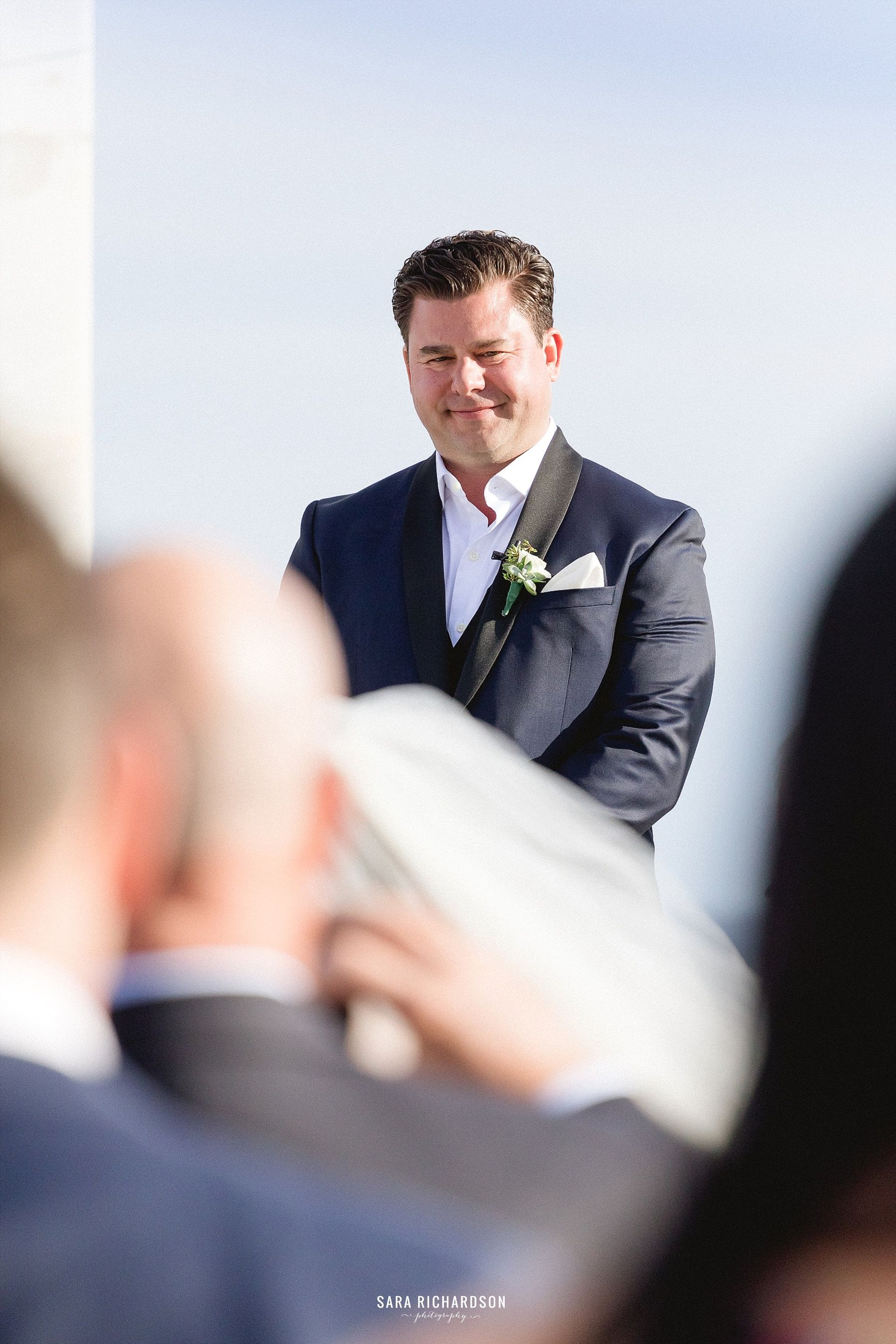Groom waiting for the Bride as she walks down the aisle for the Ceremony. This wedding was taken place at LeBlanc in Los Cabos Mexico. Photography by Sara Richardson, wedding design by Jesse Wolff