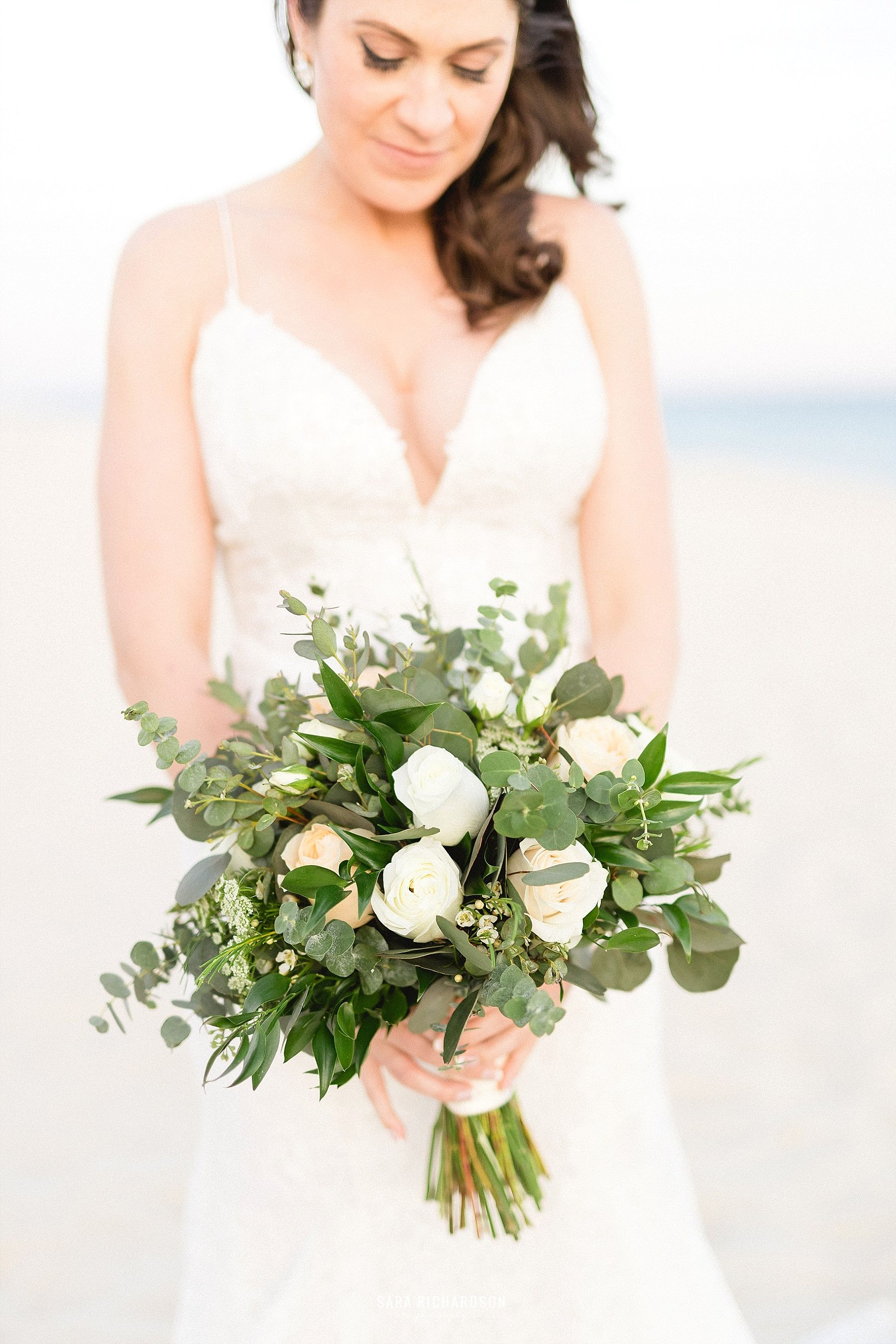 Bride with her Bouquet on her wedding day. Destination Wedding in Cabo Mexico. Wedding Planning by Cabo Wedding Services.