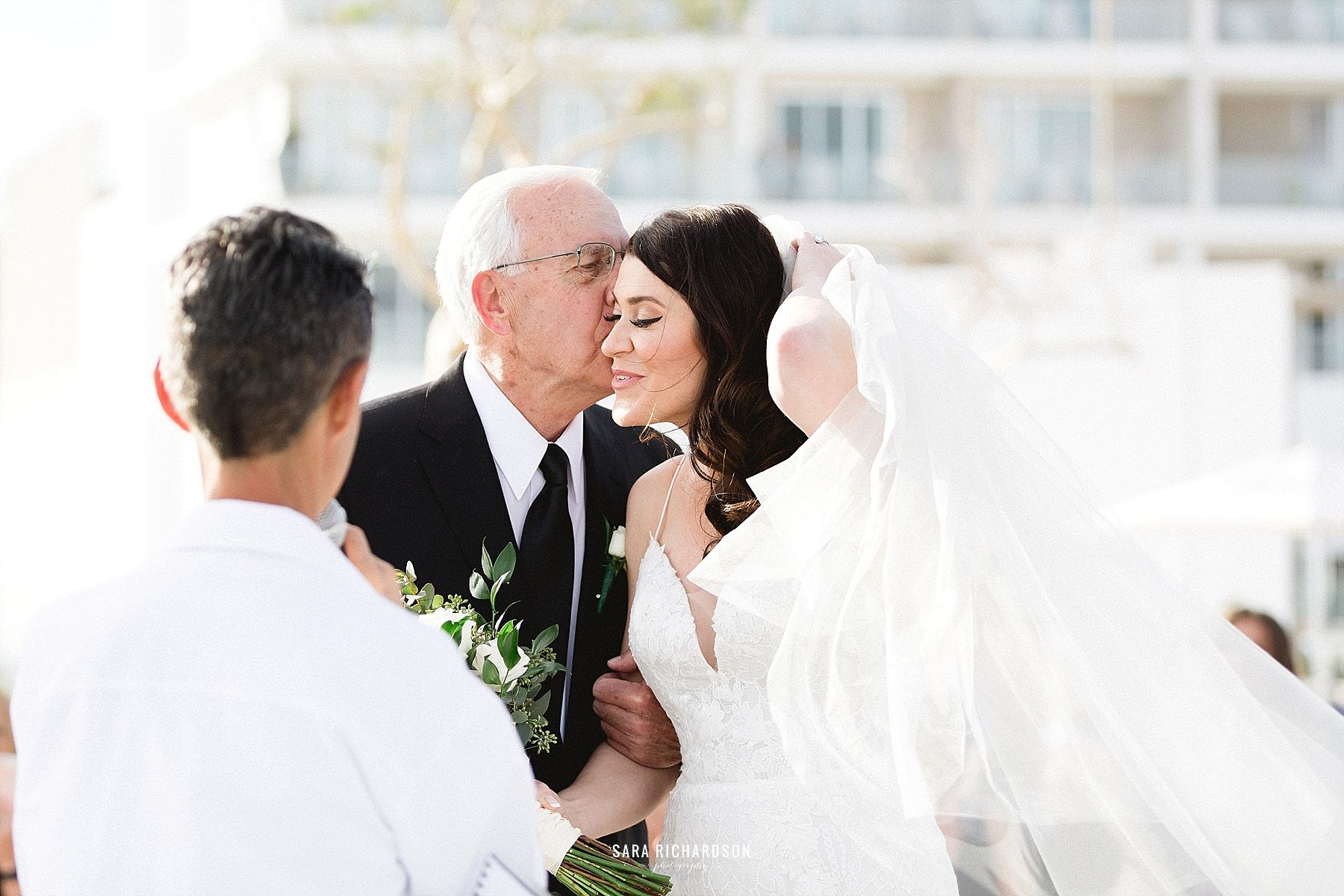 Father of Bride giving away the Bride on her Wedding Day at LeBlanc in Los Cabos Mexico. Destination Wedding in Los Cabos Mexico with Wedding Planners being Cabo Wedding Services and design by Jesse Wolff