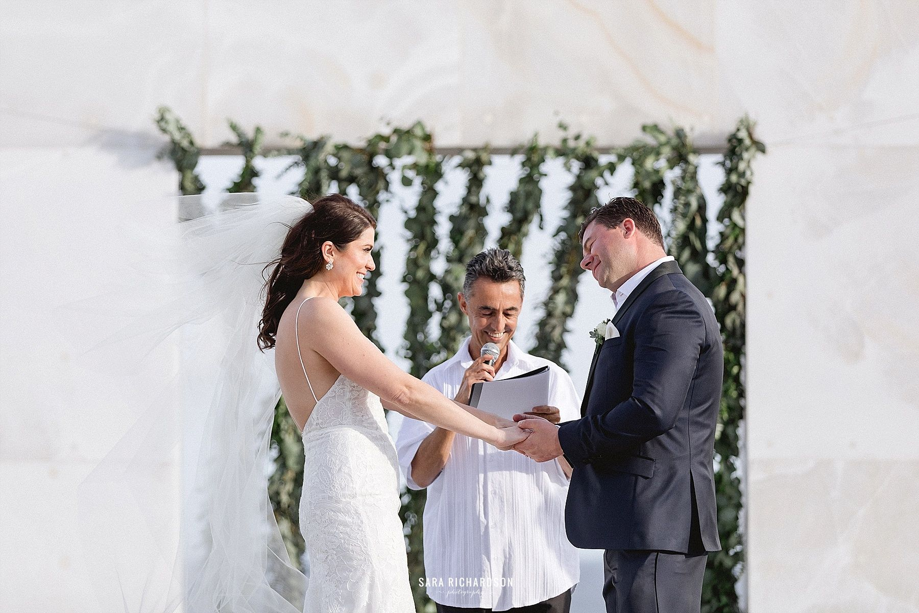 Bride and Groom saying their vows in LeBlanc Los Cabos. Photography was done by Sara Richardson and wedding planning was done by Cabo Wedding Services.