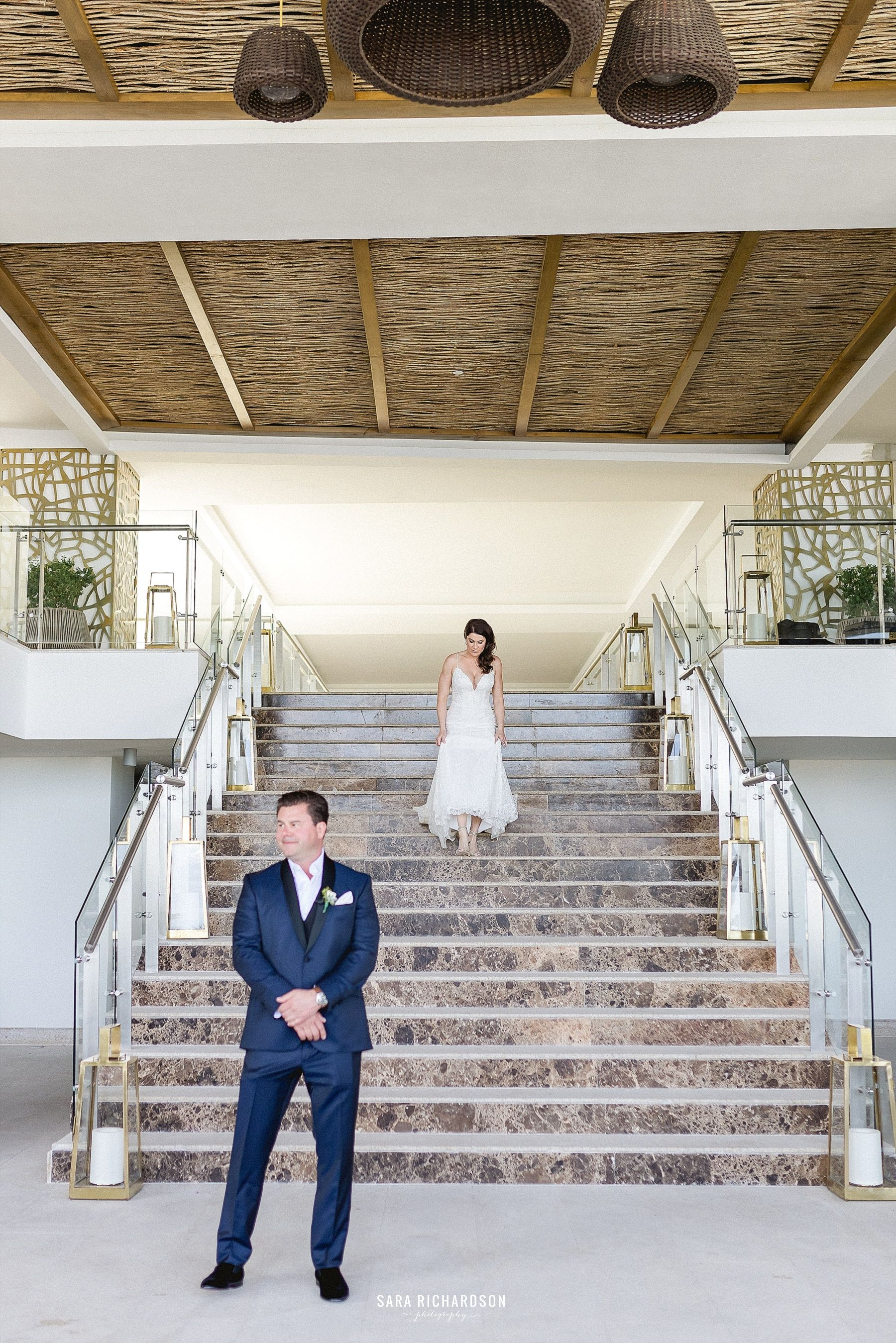 Our Bride and Groom decided to do a First Look right before the ceremony to get some more special moments before their wedding ceremony. They had such a great time doing this, and they both looked amazing! Thank you to Jimmy Choo shoes for making our Bride look amazing and making her legs look beautiful as she was walking down the stairs to do her first look!
