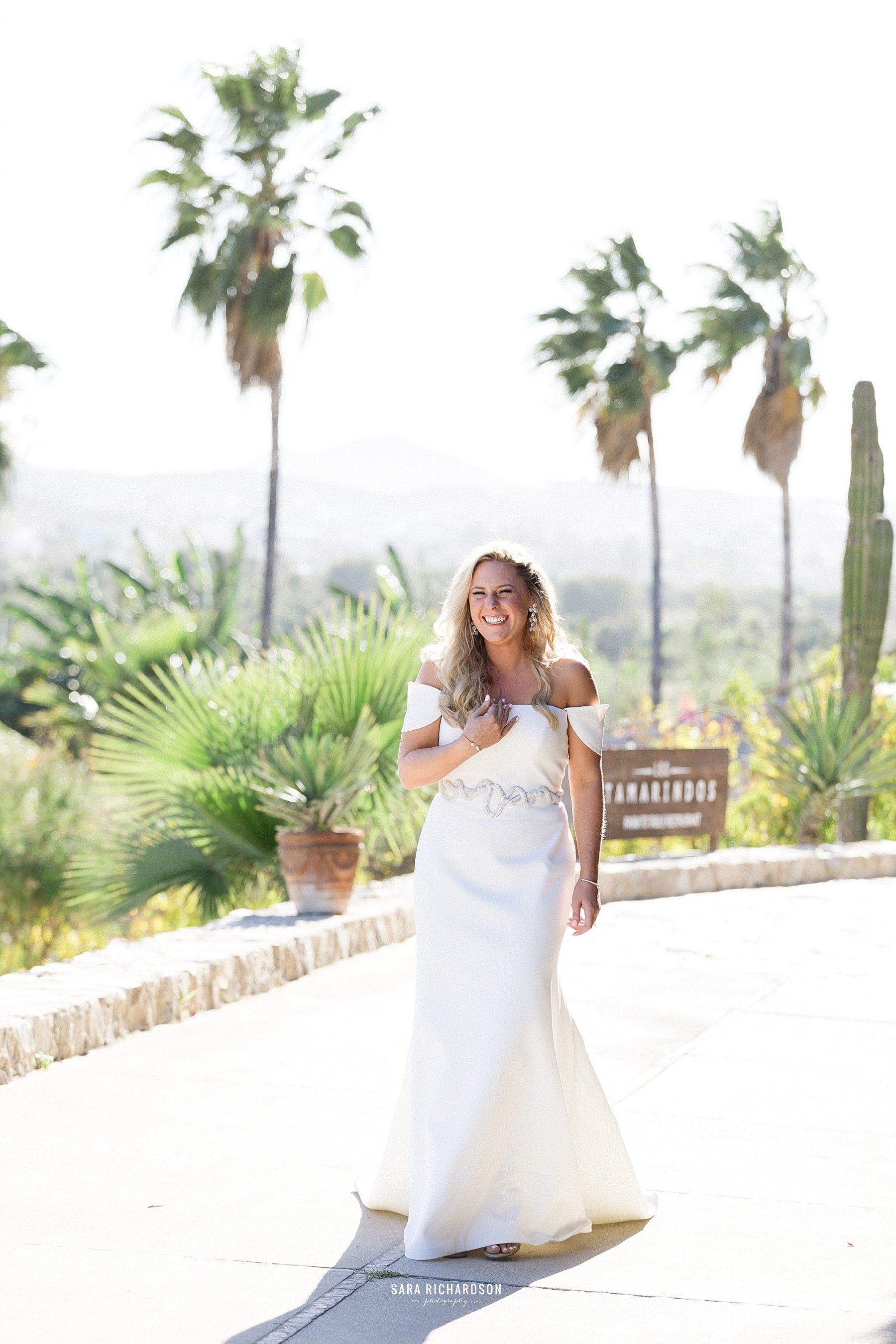Bride very happy right after the ceremony. Beautiful scenery only in Los Cabos Mexico.