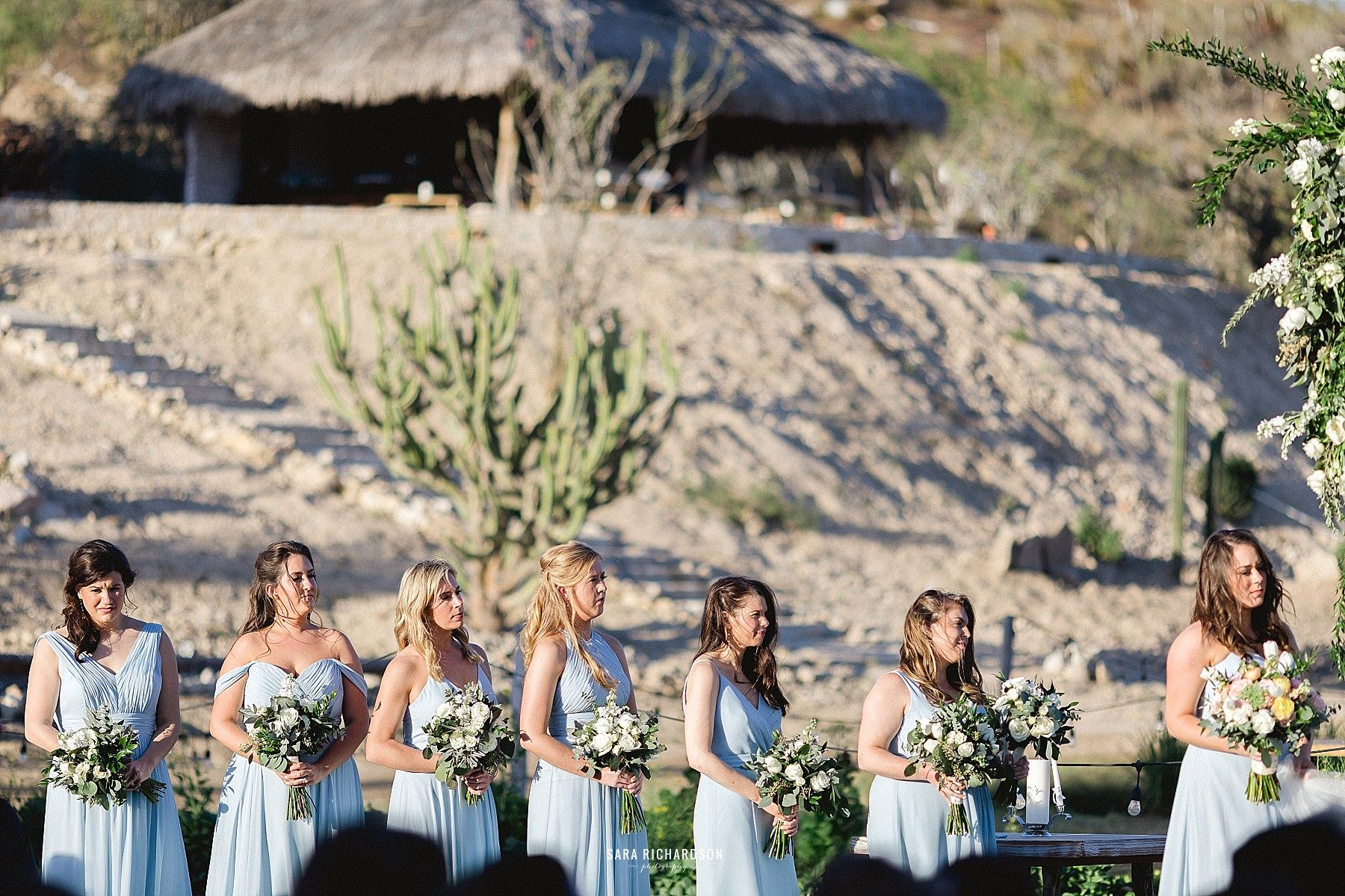 Bridesmaids standing by the Brides side as she says her I do's to the love of her life!
