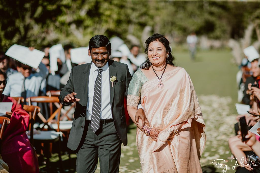Father of the Bride and Mother of the Bride walked down the Aisle at Flora Farms, before their daughter entered the Ceremony. This was an Indian Ceremony that took place at Flora Farms, in Los Cabos Mexico.