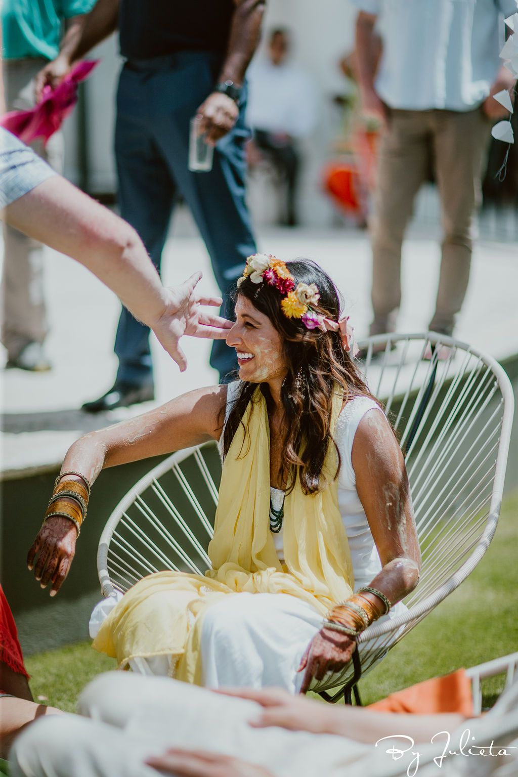 Bride getting turmeric on her during the Haldi Ceremony that took place in the morning at the Hilton Los Cabos. Cabo Wedding Services planned the whole Indian Wedding weekend.