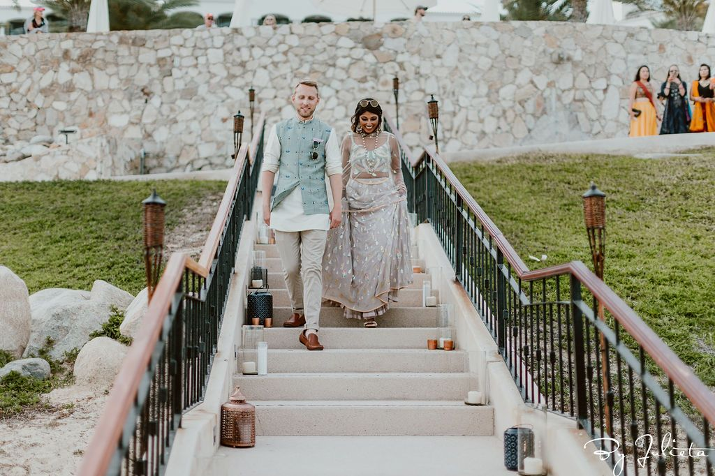 Bride and Groom walking into their Sangeet that took place at Hilton Los Cabos, in Cabo San Lucas, Mexico.