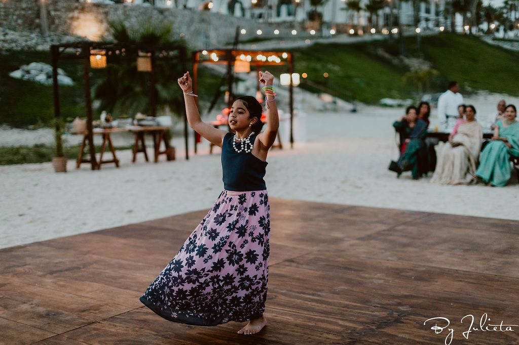 Cousin of the Bride doing a choreographed dance during the Sangeet at Hilton Los Cabos.