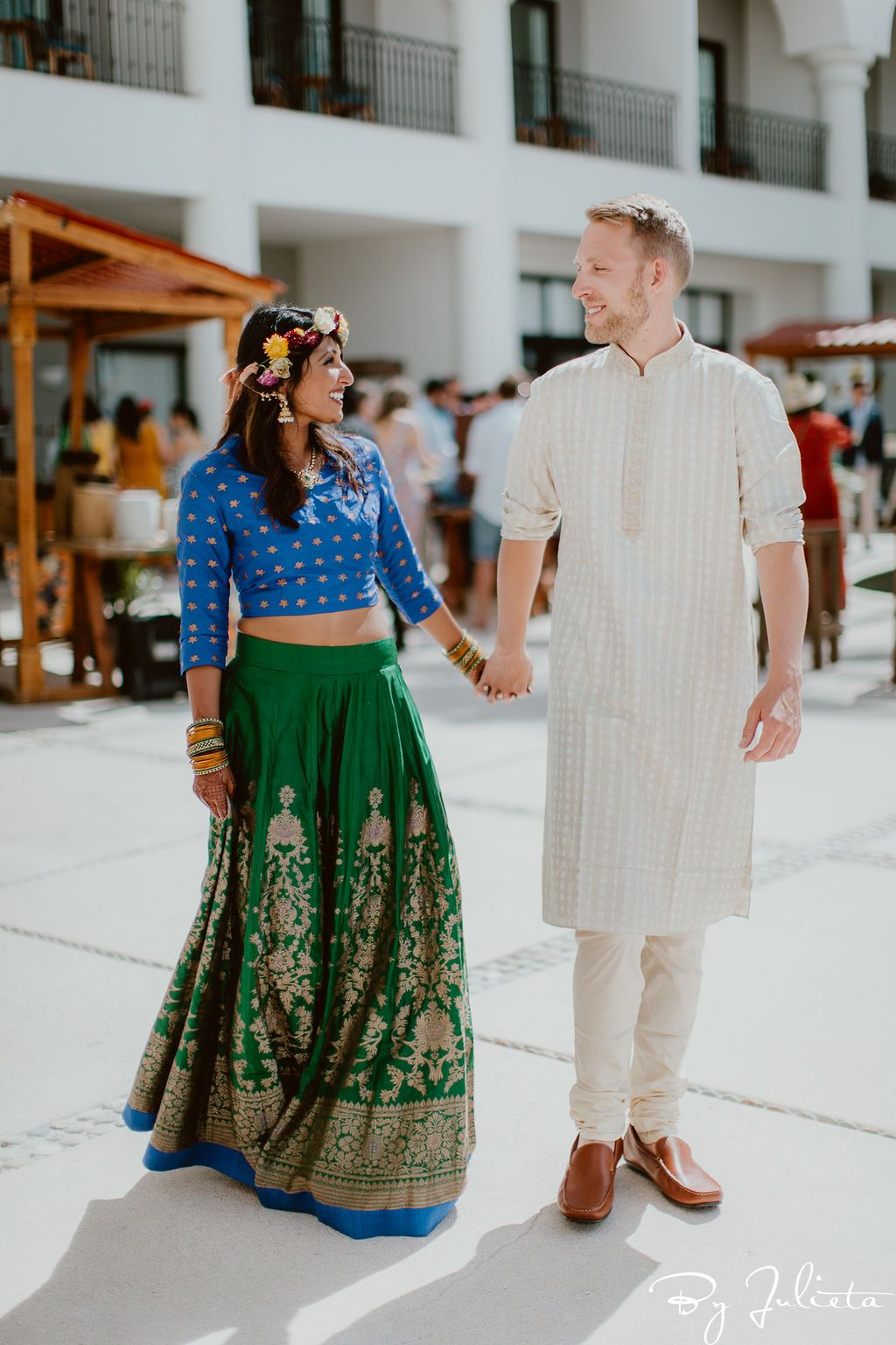 Bride and Groom posing for the amazing Julieta Amezcua, who was their photographer for their wedding weekend. They had their Haldi and Sangeet at the Hilton Los Cabos, and then their beautiful wedding at Flora Farms.