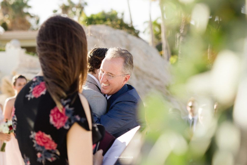 Father of Bride hugging the groom at their Destination Wedding Ceremony. It was perfect.