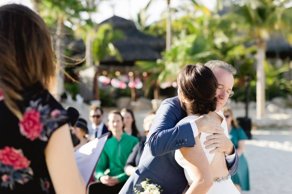 Father of the Bride hugging his daughter, giving her away to the man of her dreams, in Los Cabos Mexico.