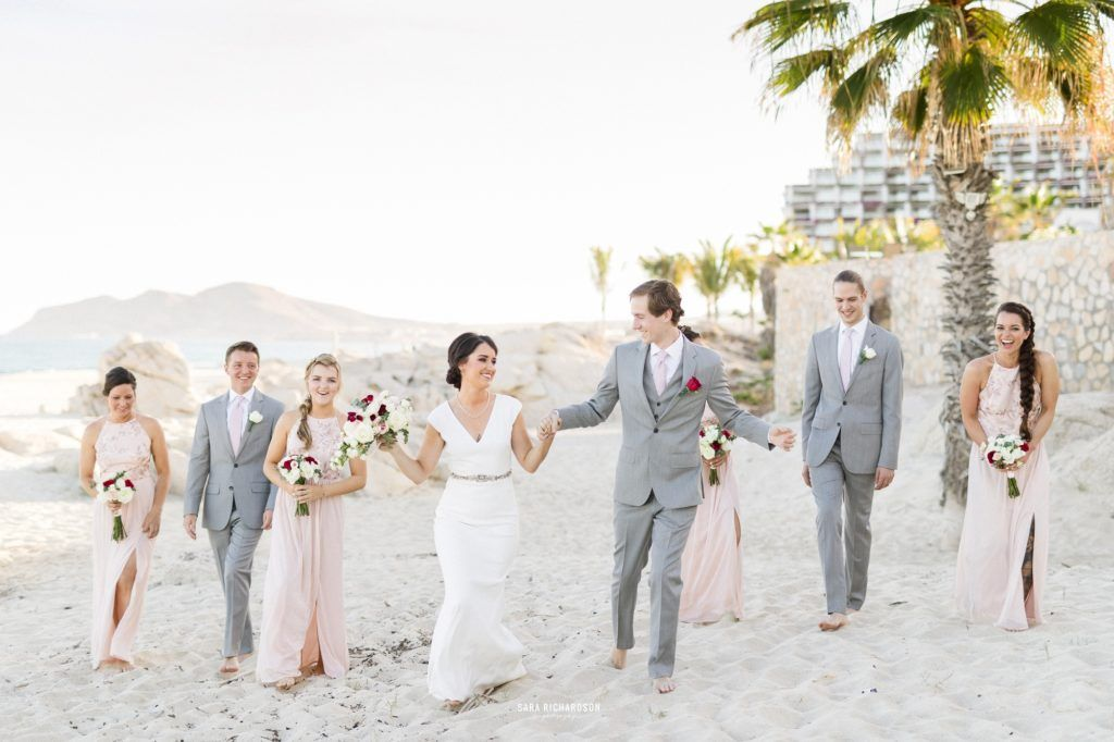Wedding Party taking their photo session on the beach at their Destination Wedding at Villa Las Rocas in Los Cabos Mexico.
