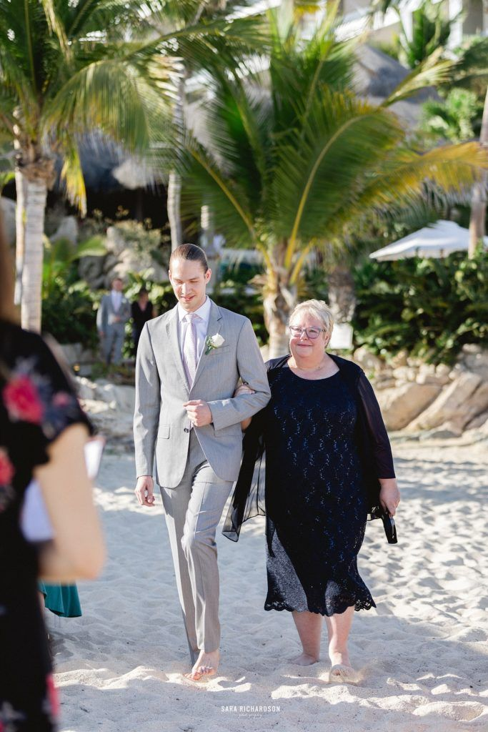 Grandmother of Groom was walking down with Grandson at her other Grandsons Destination Wedding in Los Cabos, Mexico.