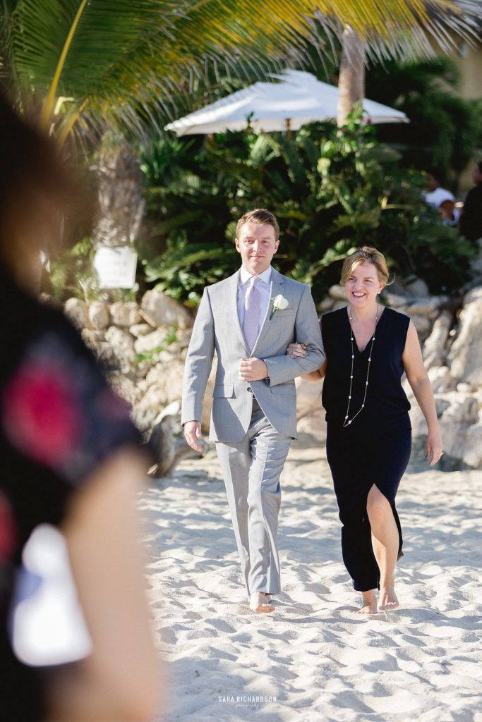 Brother and Mother of Bride walking down the aisle at their Destination Wedding in Los Cabos Mexico.
