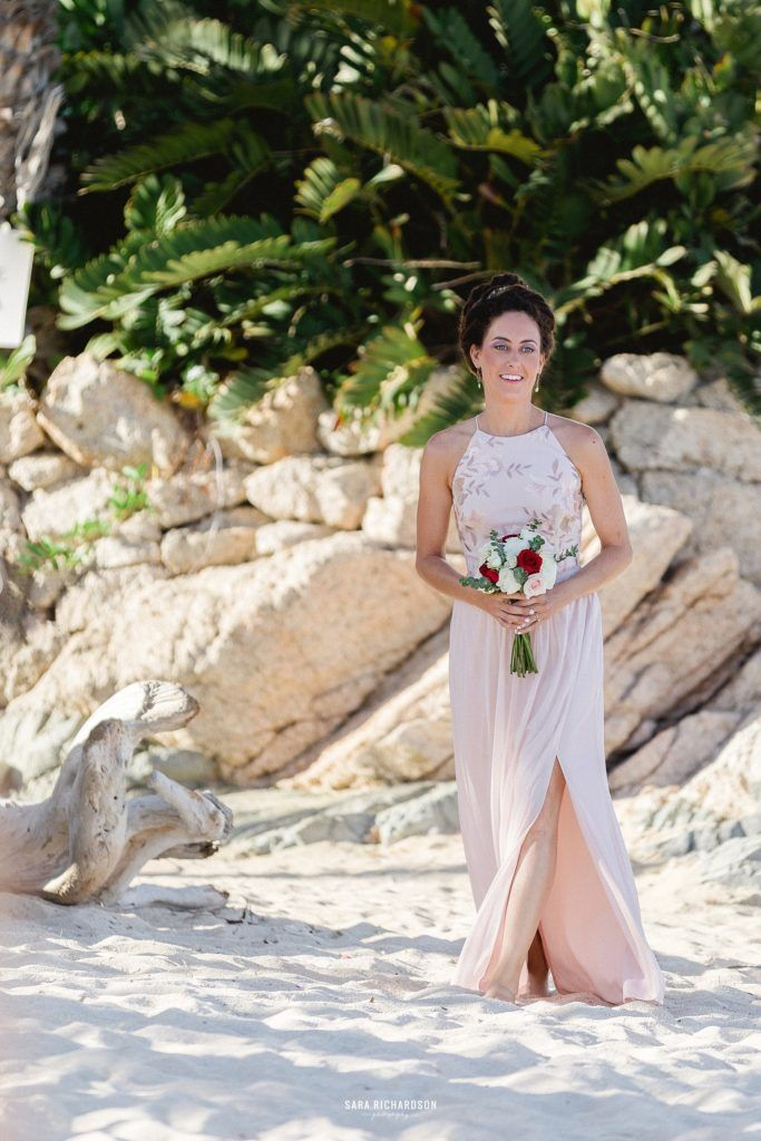 Second Maid of Honor walking down the aisle at Nicoles Destination Wedding in Los Cabos Mexico. The Wedding took place in a Private Villa in Los Cabos in front of the Sea of Cortez Ocean and it was perfect. Weather could not have been better.