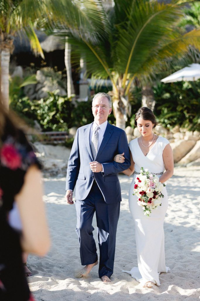 Bride walking down to her wedding with her dad. This was such an emotional moment because she the day was finally here. It was a very intimate ceremony, with just her close family and friends there to enjoy every moment of her Destination Wedding in Los Cabo Mexico.