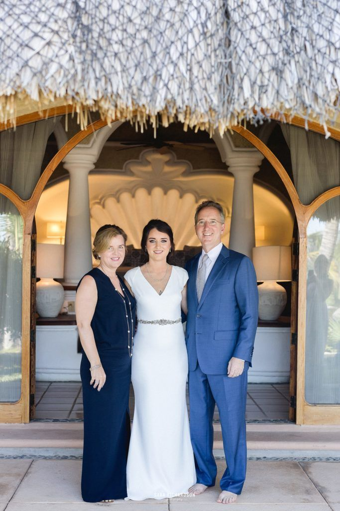 The Bride with her Mom and Dad minutes before walking down the aisle to her ceremony. She was so close with her parents, and definitely a daddy's girl. She looked amazing. She hired Cabo Wedding Services as her wedding planner and Sara Richardson photography to capture such amazing photos.