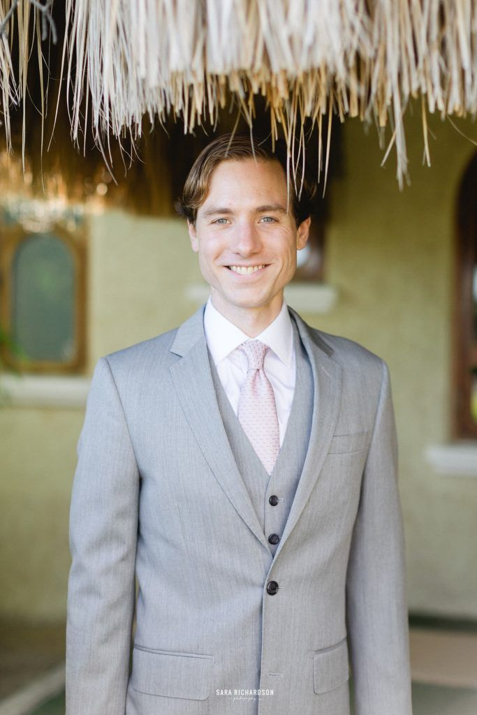 Groom posing for the camera on his wedding day. He got married in Los Cabos, Mexico, at Villa la Roca. He wore Hugo Boss for his suit and looked amazing.