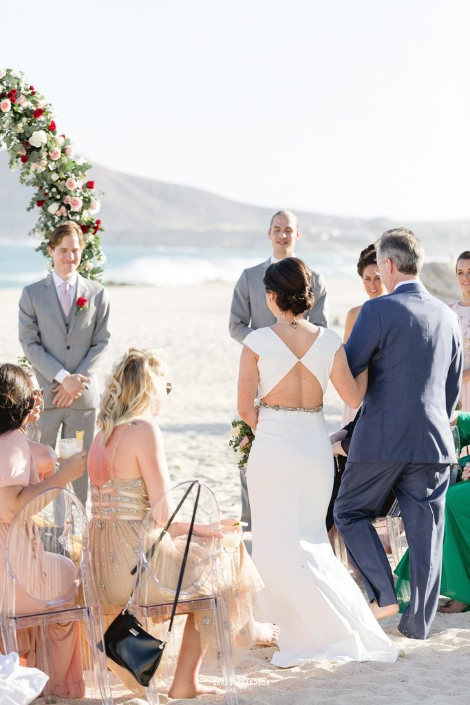 Bride almost arriving to her groom, where her dad would give her away. This was the perfect Destination Wedding in Los Cabos, Mexico.