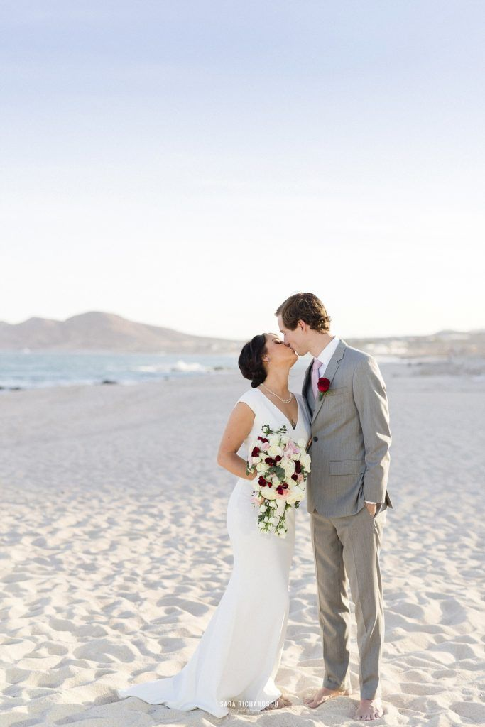 Bride and Groom Kissing right after their destination Wedding in Los Cabos Mexico