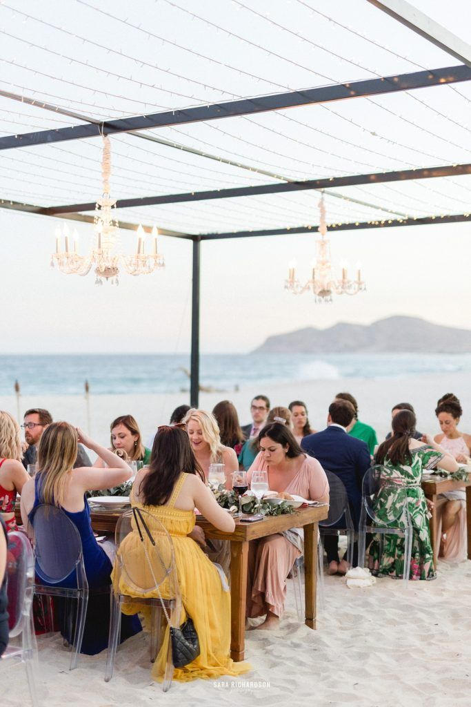 Guests eating at a Beach Wedding in Los Cabos Mexico. Wedding Planning was done by Cabo Wedding services and Catering was done by Lazy Gourmet