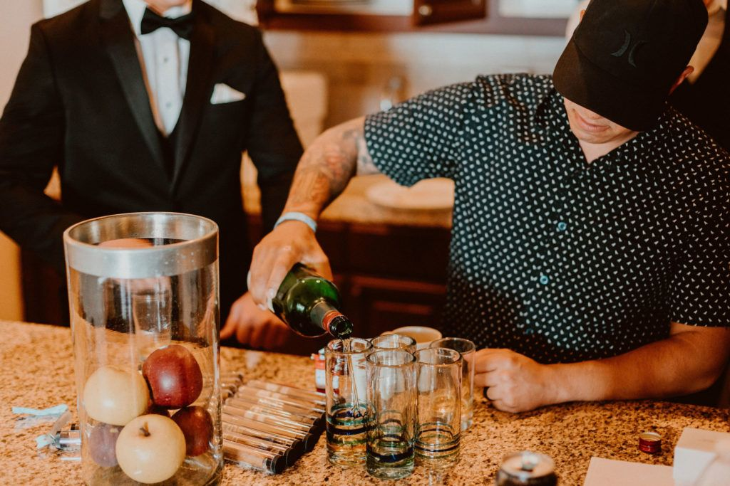 The Groomsman doing his job, by serving all of the guys a shot before leaving the Hotel property, of Pueblo Bonito Sunset Beach in Los Cabos Mexico.