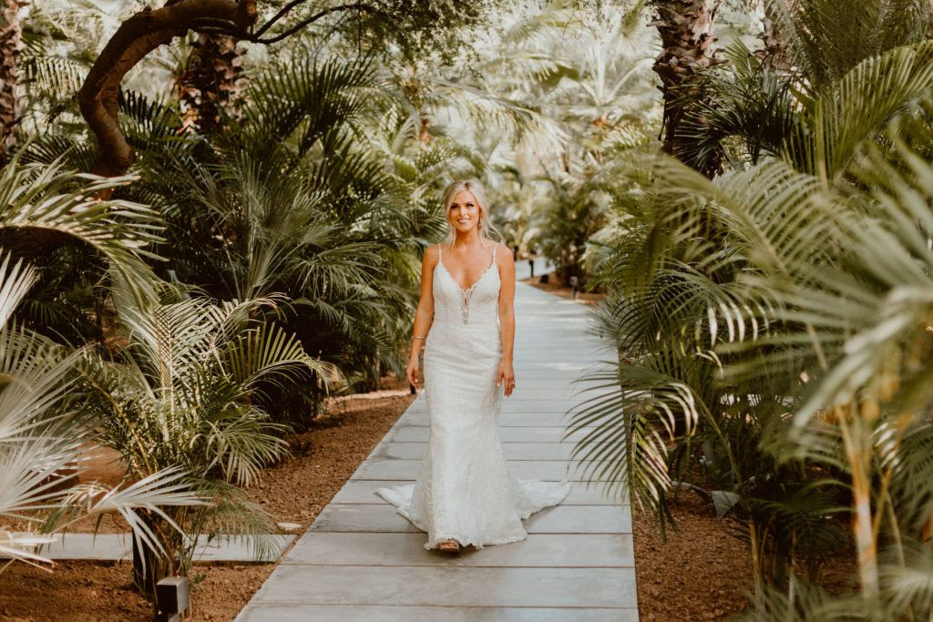 Bride walking down the path at Acre Baja ab out to see her groom for the first time, before the ceremony. They decided to do a First Look and were able to get pictures in before the Ceremony.