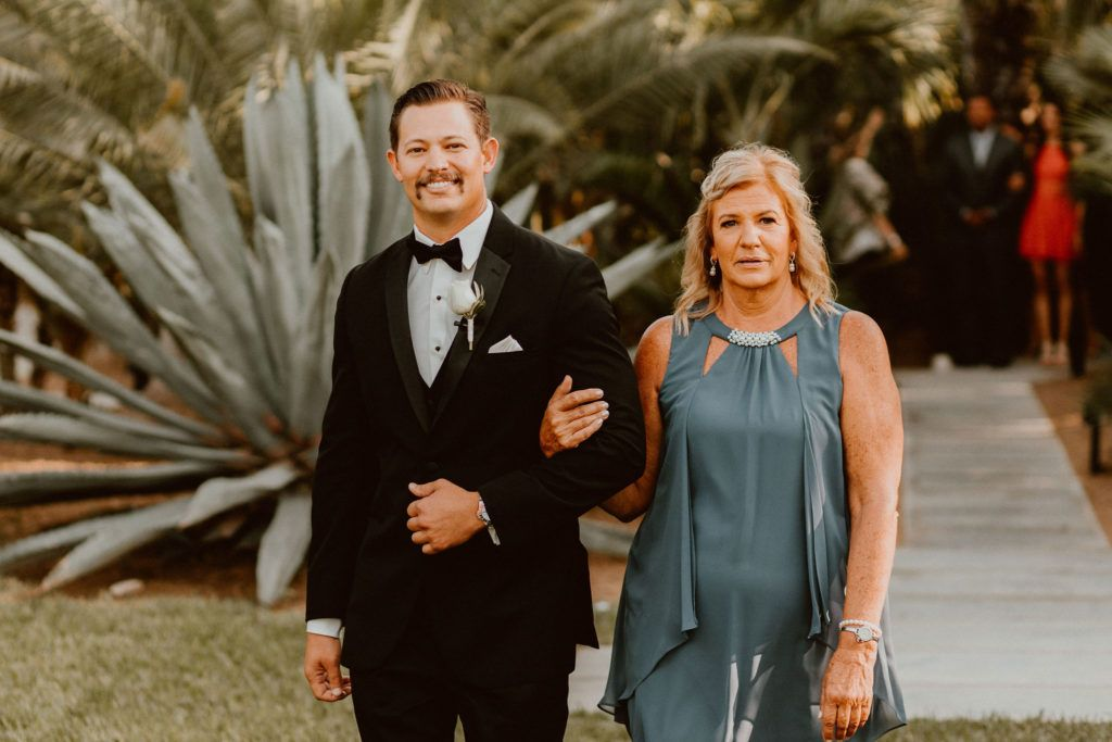 Groom walking down the Aisle with his Mother at his Destination Wedding Venue Acre Baja. Wedding Planning was done by  Jessica Wolff at  Cabo Wedding Services