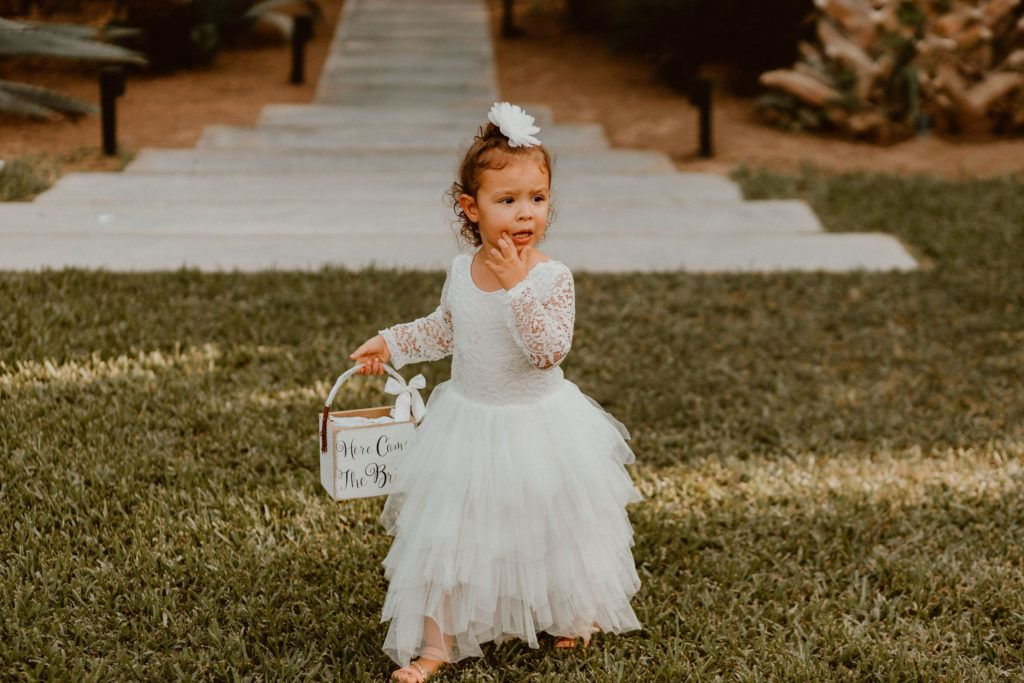 Flower Girl walking down the Aisle at Wedding Venue Acre Baja for a Destination Wedding. Wedding Planning was done by Jessica Wolff at Acre Baja.