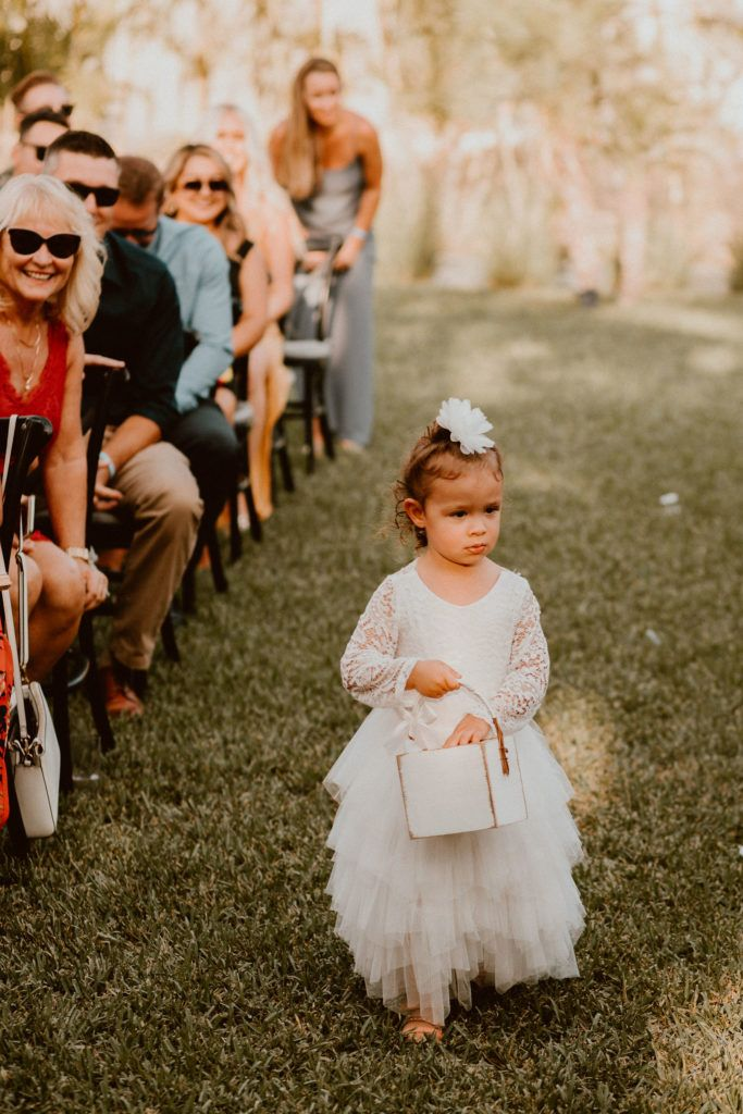 Flower Girl walking down the Aisle at Destination Wedding Venue Acre Baja in Los Cabos Mexico. Wedding Planning was done by Cabo Wedding Services, Jessica Wolff