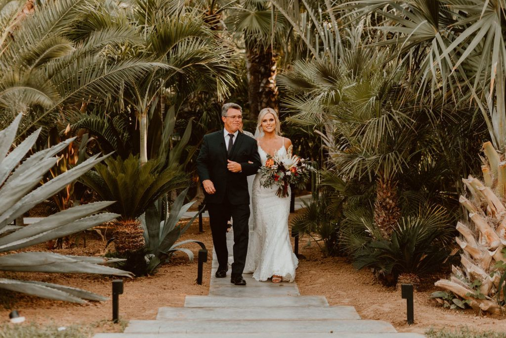 Bride walking the aisle down at Destination Wedding Venue Acre in Los Cabos Mexico. This wedding took place in October of 2019 and Jessica Wolff from Cabo Wedding Services was her Wedding Planner. Her wedding Photographers were Ana and Jerome.