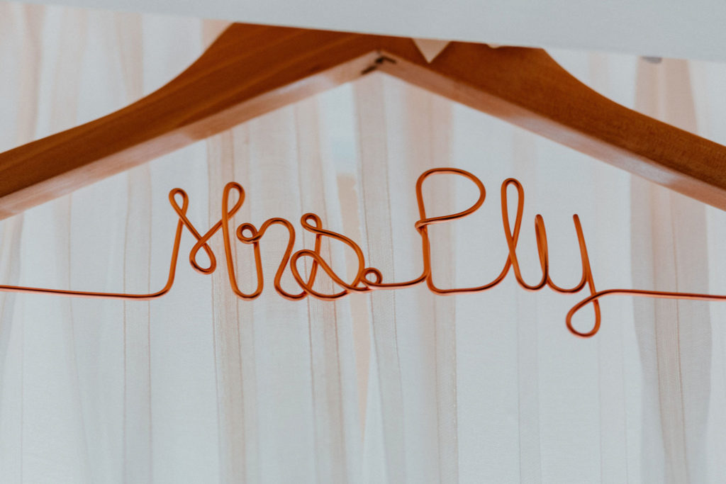 Brides hanger at her hotel room at Pueblo Bonito Sunset Beach. She decided to get it personalized with her future last name.
