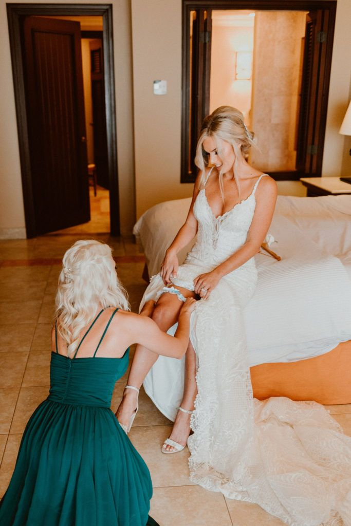 Brides Maid of Honor helping her get her shoes on prior to doing the First Look with her Groom. Although Ariel was nervous, she was so excited and laid back on her big day prior to saying her I Do's.