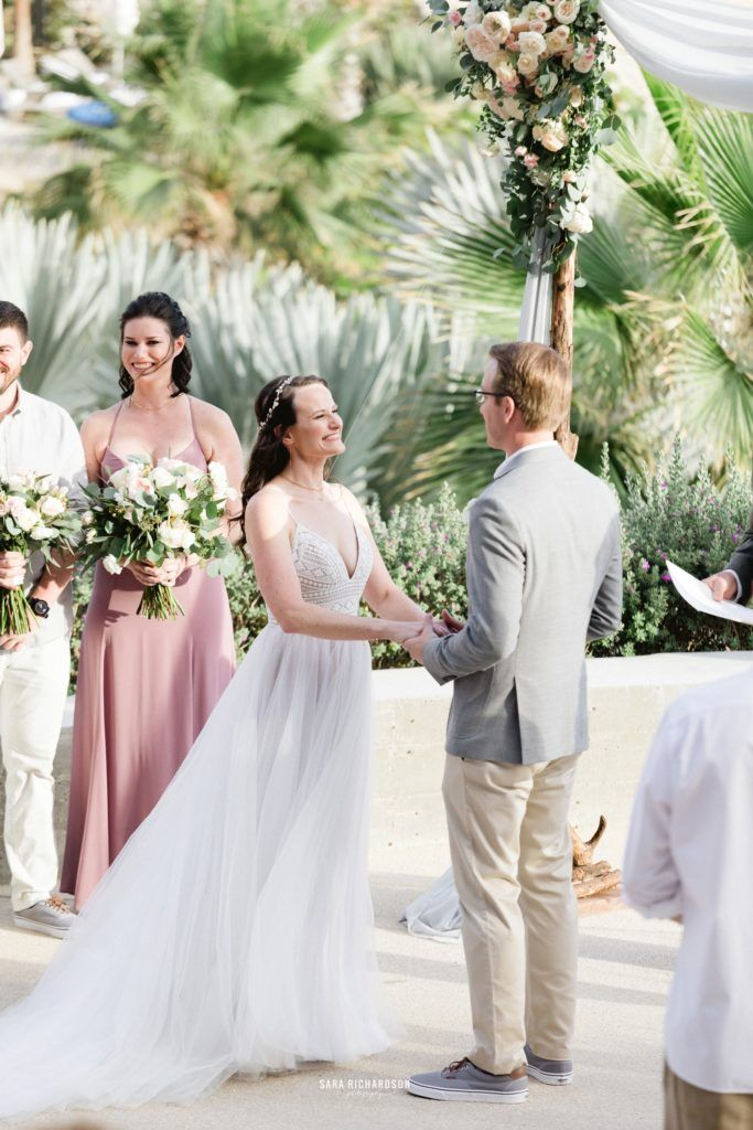 Bride and Groom getting Married at The Cape in Los Cabos Mexico. They are standing in front of the Sea of Cortez and the world renown Arch in Los Cabos Mexico. Wedding planning was done by Cabo Wedding Services by Jesse Wolff