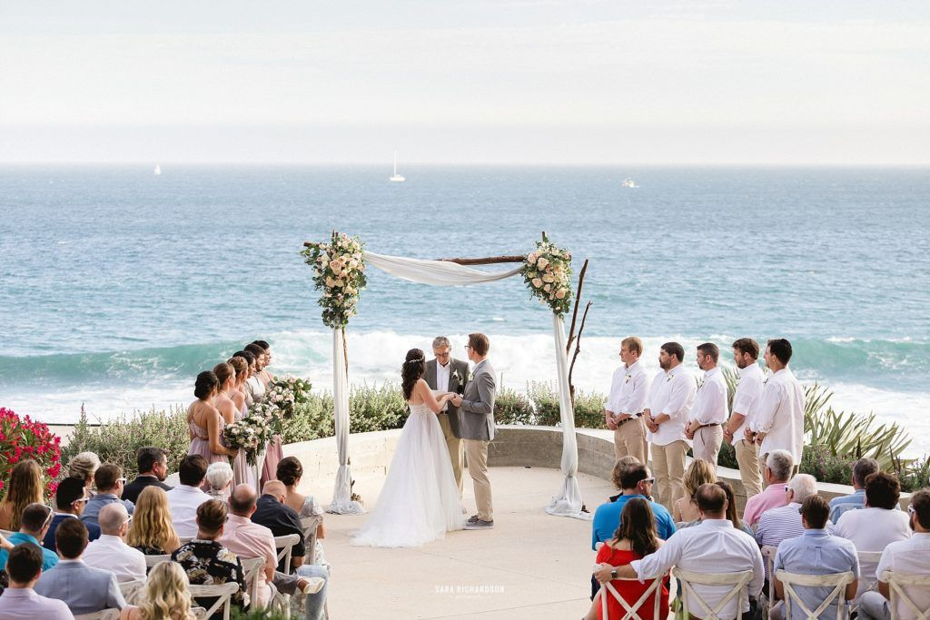 Ceremony happening at The Cape in Los Cabos Mexico. Wedding Planning was done by Cabo Wedding Services by Jesse Wolff