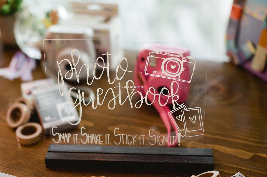 Guest Signing Book with a Polaroid Camera.