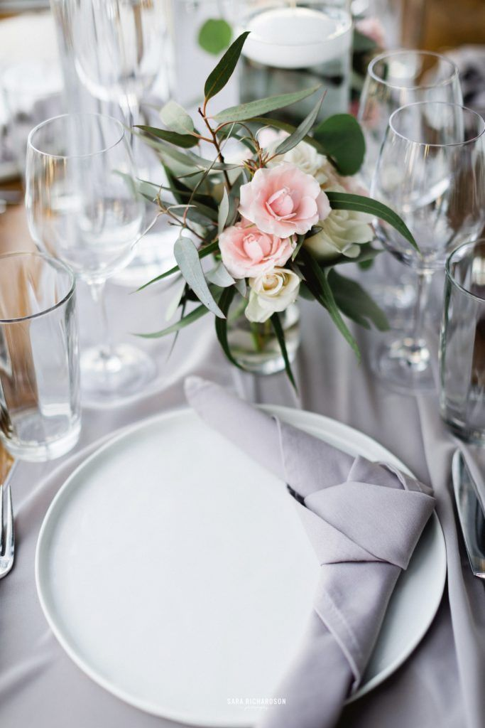 Table setting and design by Jesse Wolff at Cabo Wedding Services, in Los Cabo Mexico. Gray Table Runner, Gray Linen with beautiful white ceramic chargers.