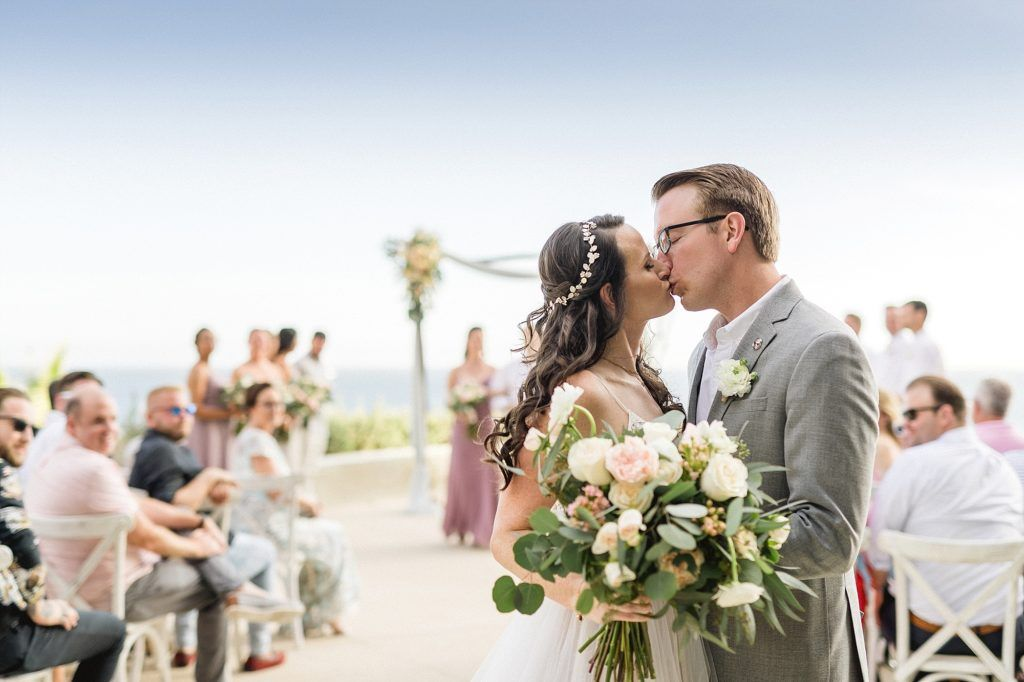 Bride and Groom's first kiss as husband and wife. Wedding took place at The Cape in Los Cabos Mexico. Wedding planning done by Jesse Wolff at Cabo Wedding Services in Los Cabos Mexico.