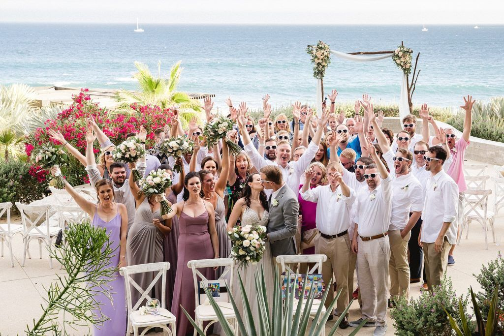 Group  Photo celebrated at The Cape by Cabo Wedding Services. Wedding planning was done by Cabo Wedding Services