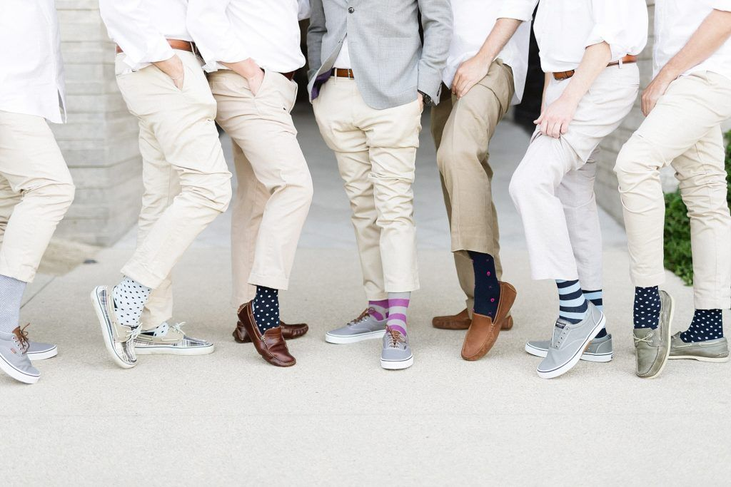 Groom with his Groomsmen showing of their Target socks. It is always super fun to get something that adds color for a photo session.