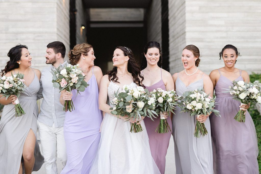 Bride with Bridesmaids doing a Photo Session with their bouquets and in their Bridesmaid Dresses. This wedding was done at The Cape in Los Cabos Mexico. Destination Wedding Planner was Jesse Wolff by Cabo Wedding Services