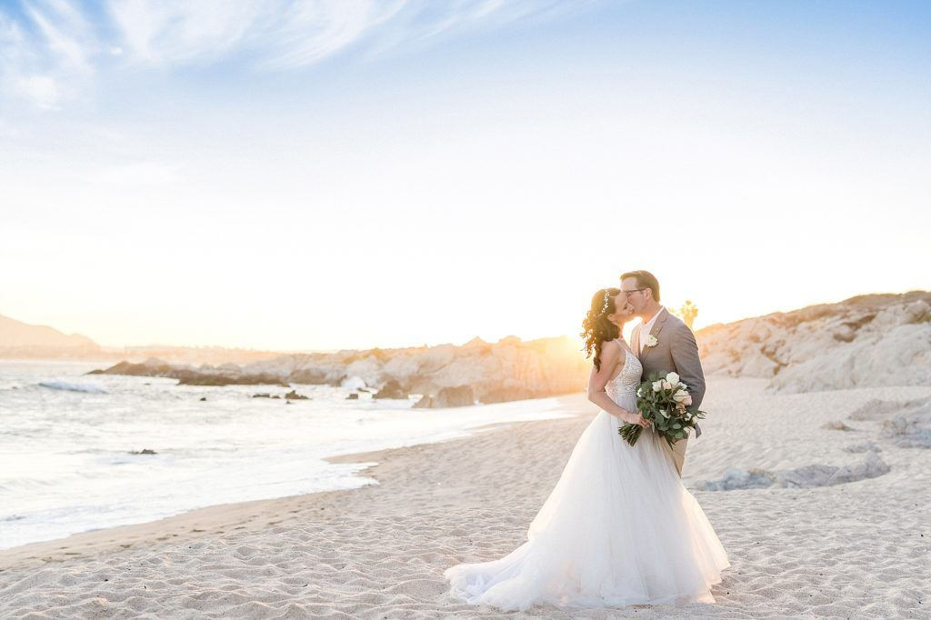 Bride and Groom doing a Photo Session in Cabo San Lucas, Mexico, right infant of The Cape, after their Wedding Ceremony. Wedding Planning by Cabo Wedding Services