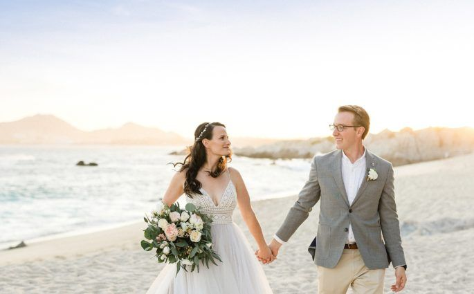 Bride and Groom walking on the beach after the Ceremony at The Cape in Los Cabos, Mexico