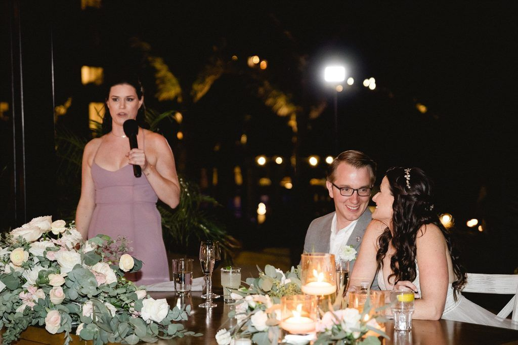 Toasts were being done at this point, which is why the Maid of Honor was standing next to the Bride and Groom
