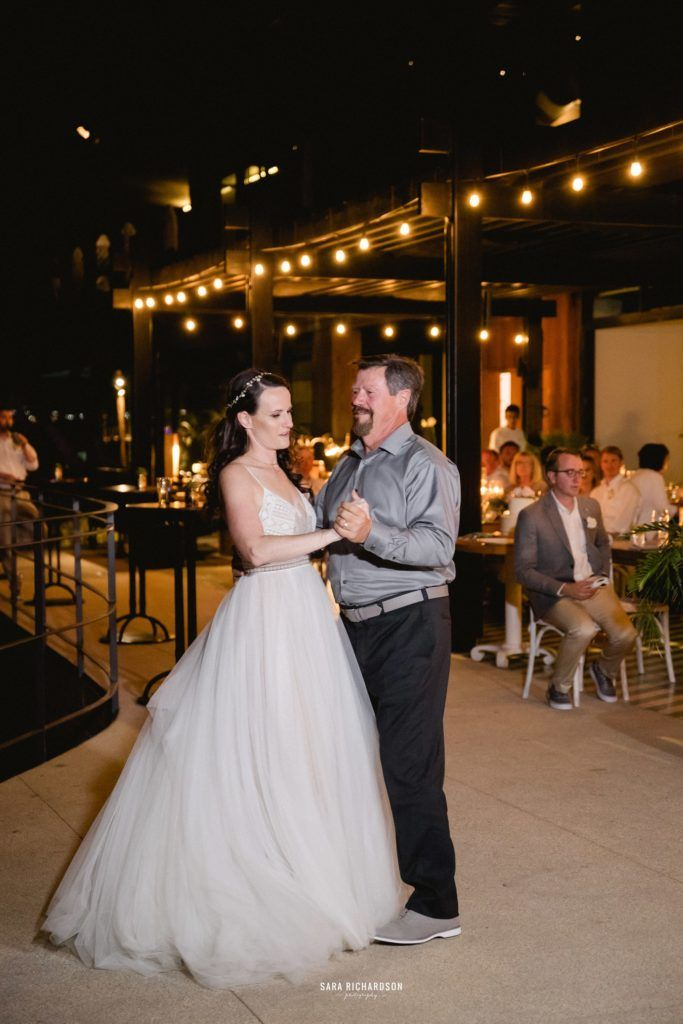 Bride is doing the Father Daughter dance in front of all of her guests at The Cape, in Los Cabos Mexico