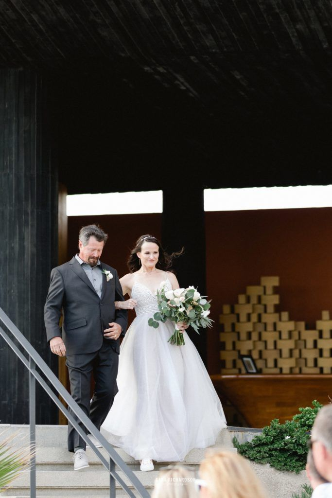 Bride walking down with her dad at The Cape in Los Cabos Mexico. Wedding Planning done by Cabo Wedding Services