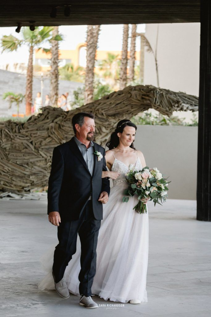 Bride walking down the Aisle at The Cape in Los Cabos Mexico. Destination Wedding Planning was done by Jesse Wolff from Cabo Wedding Services