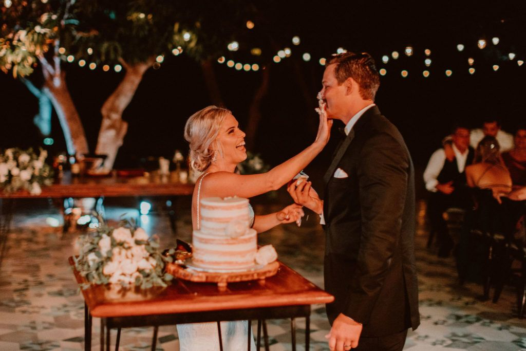 Bride and Groom cutting the Cake at Acre Baja in Los Cabos Mexico